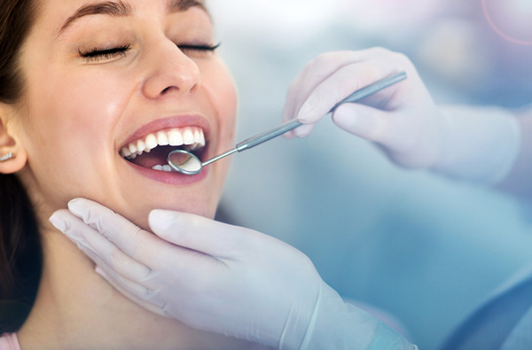 Woman getting dental exam and cleaning from Dr. Bethany Polnar in Natick, MA